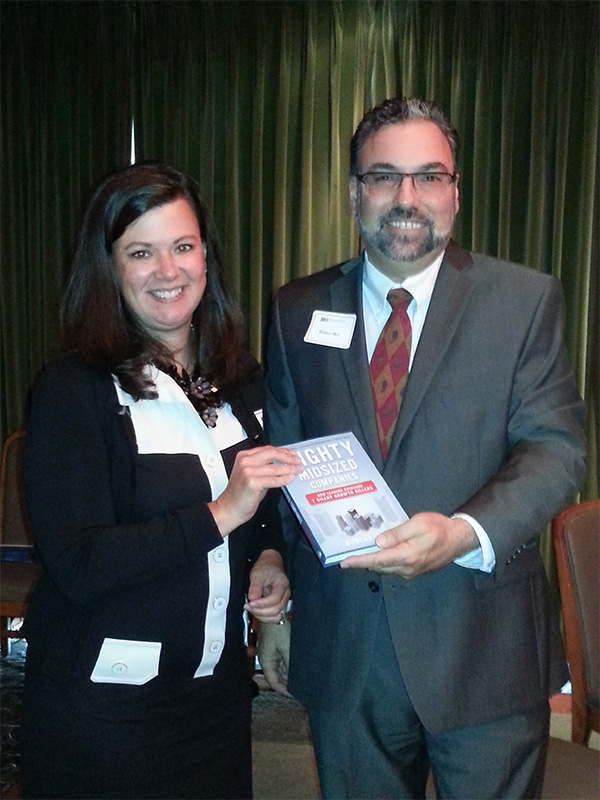Robert Sher presenting his book to our drawing winner, Kimberly Crosslin.