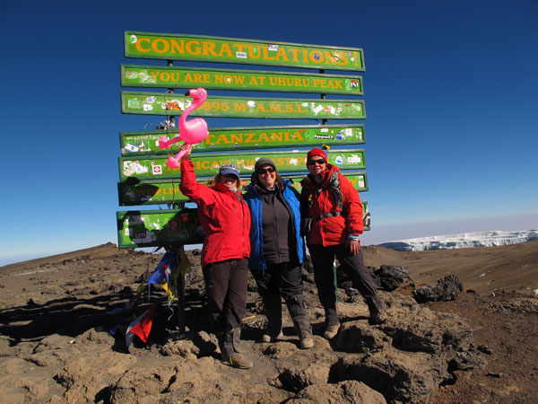 Emilie with two of her clients at the summit of Kilimanjaro in September 2013